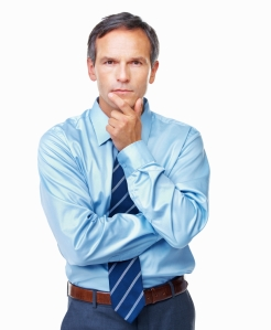 This is a stock photo of a guy thinking. Could he be thinking about where to invest his money? He could be. It's hard to tell because he was actually paid to stand there and look like this and we can't ask him.
