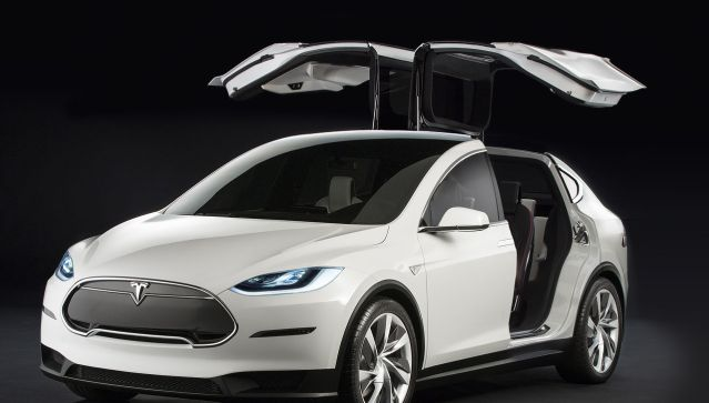 "This is the Tesla Model X. It's due to hit the road in 2016, and is gorgeous. Notice the ""Falcon Wing."" Notice it! Did you notice it?  Awesome, right?"