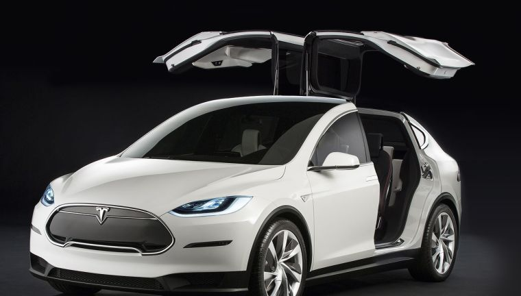 """This is the Tesla Model X. It's due to hit the road in 2016, and is gorgeous. Notice the """"Falcon Wing."""" Notice it! Did you notice it?  Awesome, right?"""